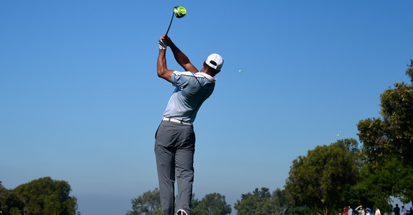 Tiger Woods plays his tee shot on the 15th hole of the north course during the first round of the Farmers Insurance Open at Torrey Pines Golf Course on February 5, 2015 in La Jolla, California. (Donald Miralle/Getty Images North America)