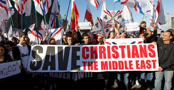 Assyrian Christians who fled the unrest in Syria and Iraq demonstrate during a gathering in front of the UN house in Beirut, Lebanon, on Saturday. (EPA)