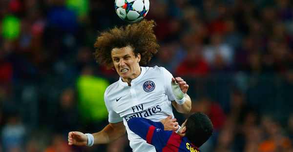 David Luiz of PSG outjumps Luis Suarez of Barcelona during the UEFA Champions League Quarter Final second leg match between FC Barcelona and Paris Saint-Germain at Camp Nou on April 21, 2015 in Barcelona, Spain. (Clive Rose/Getty Images Europe)