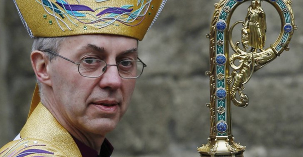 The Archbishop of Canterbury Justin Welby leaves after his enthronement ceremony at Canterbury Cathedral, in Canterbury, southern England March 21, 2013. (Luke MacGregor/Reuters)