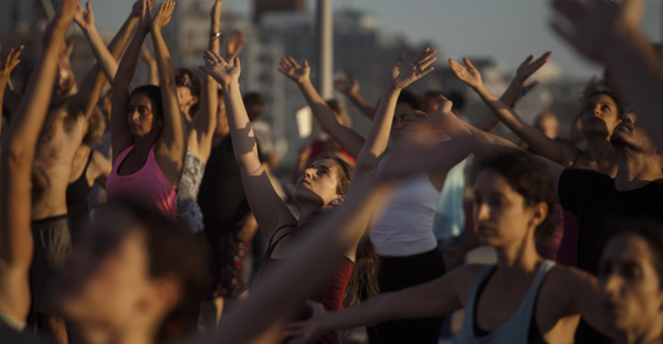 Israelis perform Yoga during the International Yoga Day in Tel Aviv, Israel, Sunday, June 21, 2015. Thousands of yoga enthusiasts took part in mass yoga programs to mark the first International Yoga Day throughout the world. (AP Photo/Dan Balilty)
