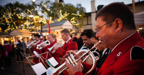 Salvation Army musicians in the group's USA Western Territory play outdoors during the holiday season. Such bands, which grew up with the 150-year-old evangelical Christian church since its founding in the East End of London, are intended to convey a gospel message. (The Salvation Army USA Western Territory)