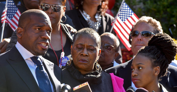 Rev. Jamal Bryant announced this morning that he is running for the 7th Congressional seat, now held by Rep. Elijah Cummings. At center is his mother, Cecilia Bryant, and at right is his 15-year old daughter, Naomi. He spoke outside the Freddie Gray Youth Empowerment Center on Eutaw Place. (Amy Davis / Baltimore Sun)