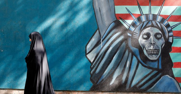 An anti-American mural along a street in Tehran. The United States and Iran each face domestic pressures against closer relations, a nuclear deal notwithstanding. (Abedin Taherkenareh/European Pressphoto Agency)
