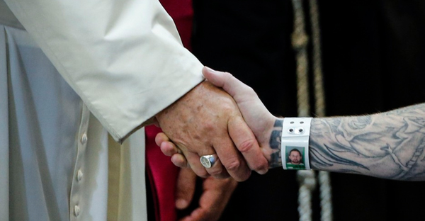 Pope Francis shakes an inmate's hand at the Curran-Fromhold Correctional Facility in Philadelphia (Jonathan Ernst / Reuters)