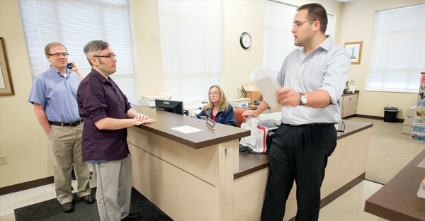 Rowan County Deputy Clerk Nathan Davis, right, informs David Moore, center, and David Ermold, left, that he won't issue them a marriage license Thursday, August 13, 2015 at the Rowan County Clerk's office in Morehead, Ky. Moore and Ermold were at the courthouse early Thursday following an order by a federal judge that Rowan County Clerk Kim Davis issue the licenses, despite her religious convictions. (Photo: John Flavell/TNS/Newscom)