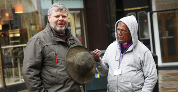 An Anglican Primate (R) and a member of the communion office chat outside Canterbury Cathedral which is hosting the Primates of the Anglican Church meeting, in Canterbury, January 11, 2016. (REUTERS/EDDIE KEOGH)