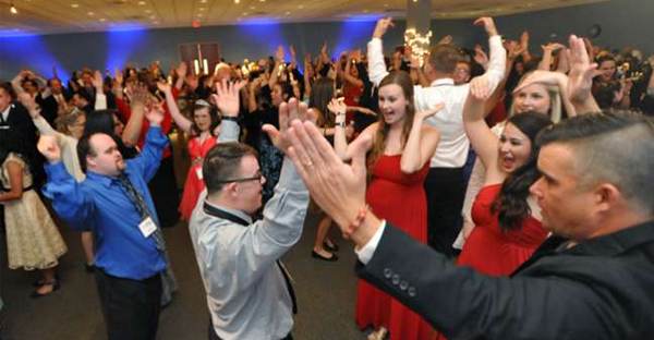"""VIP Guests and chaperones dance to """"YMCA"""" during the Night to Shine, a prom for special needs youth sponsored by the Tim Tebow Foundation Friday night, February 12, 2016 at Christ's Church in Jacksonville, Florida. (Will.Dickey@jacksonville.com)"""
