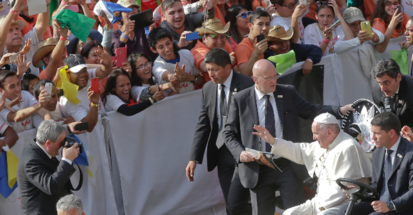 Pope Francis was cheered by youths as he arrived at the stadium in Morelia, Mexico, Feb. 16, 2016. (Gregorio Borgia / AP)