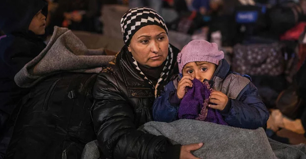 Refugees wait for a train to Serbia on the Greek-Macedonian border on 25 February 2016. 'The EU is a rich bloc of 500 million inhabitants that should be capable of managing the arrival of hundreds of thousands of desperate people.' (Photograph: Robert Atanasovski/Getty/AFP)