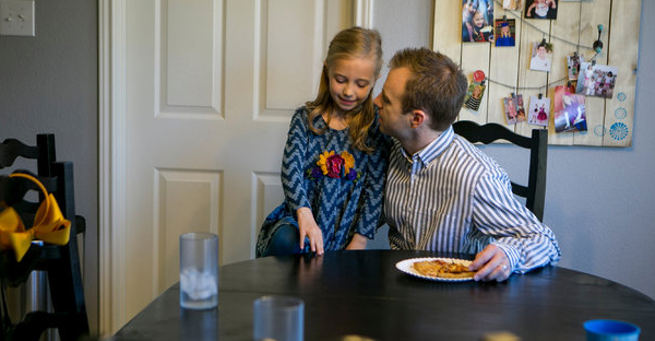 Kyle Burkholder, the teaching pastor at Grace Point Church in San Antonio, with his daughter Bella. (Credit: Ilana Panich-Linsman for The New York Times)
