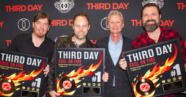 L-R: THIRD DAY's Mark Lee and David Carr, Provident Label Group President & CEO Terry Hemmings, THIRD DAY's Mac Powell