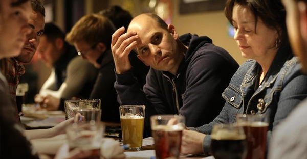 Brandon Brown listens during a Jesus + Beer session at Bernie's Tap Room in Waukesha. (Credit: Gary Porter / For the Journal Sentinel)