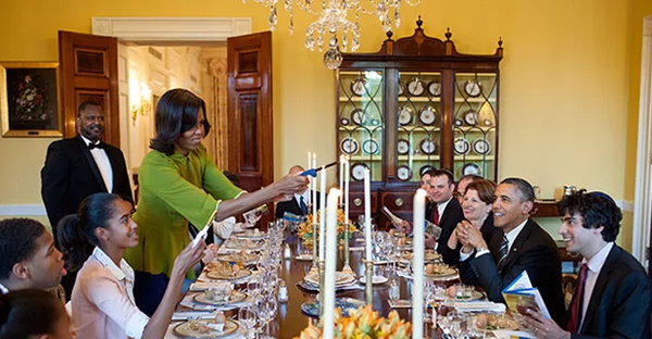 Michelle Obama lights candles during a Seder at the White House in 2012. (Photograph: Pete Souza/The White House)