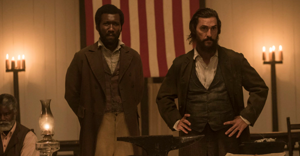 At a meeting of the Union League, Moses (Mahershala Ali) and Newt (Matthew McConaughey) tell the Freedman that all citizens shall have the right to vote. (Photo courtesy of STX Entertainment)