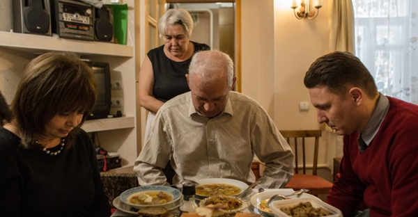 Tatyana Kravchenko, Alexey and Lyubov Koptev, and Ivan Belenko pray before dinner in Koptevs' house in November 2015. Tatyana and Alexey were two of 16 Jehovah's Witnesses who were accused of extremist activity.  (Photo by Alexander Aksakov/For The Washington Post).