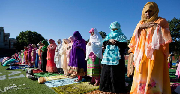 Muslims pray during a service for the Eid al-Adha holiday, Monday, Sept. 12, 2016, in the Queens borough of New York. (AP Photo/Mark Lennihan)
