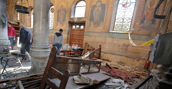 Egyptian security officials and investigators inspect the scene following a bombing inside Cairo's Coptic cathedral, Dec. 11. (PHOTO: REUTERS)