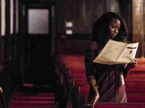 A woman reads a program during a memorial service remembering the victims of the mass shooting at Emanuel African Methodist Episcopal Church. (Sean Rayford/Getty Images)