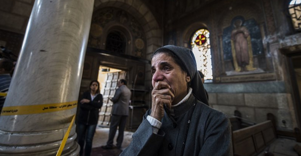 A nun reacts as Egyptian security forces work at the scene of an explosion at the Saint Peter and Saint Paul Coptic Orthodox Church in Cairo Sunday. (Khaled Desouki/AFP/Getty Images)