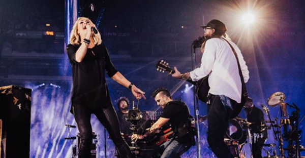 Carrie Underwood performs with David Crowder at Passion Conference 2017