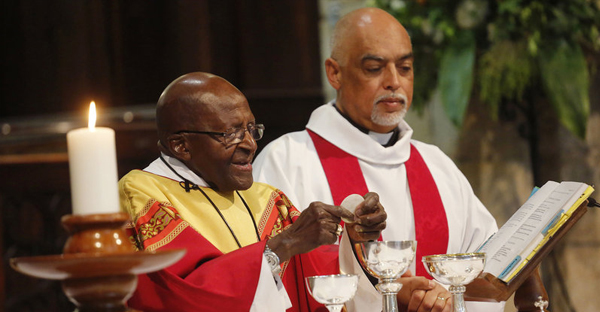 Anglican Archbishop Emeritus Desmond Tutu (left) celebrates Mass on his 85th birthday at St. George's Cathedral in Cape Town, South Africa, on Oct. 7. Tutu has called for the right to assisted death, which is currently illegal in his country. (Schalk van Zuydam/AP)