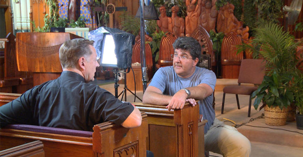 60 Minutes producer Guy Campanile talks with Fr. Michael Pfleger, pastor of St. Sabina Church on the South Side (CBS NEWS)