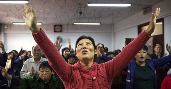A Chinese Christian woman sings during a prayer service at an underground Protestant church in Beijing. (Kevin Frayer / Getty)