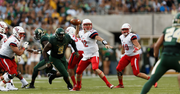 QB Stephen Calvert (12) of Liberty University makes a throw against Baylor University on September 2, 2017. (Photo by Joel Coleman/Liberty University)