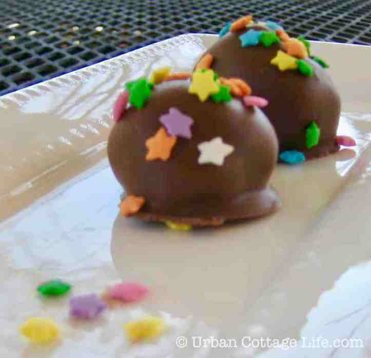 An empty space with just a few sprinkles where a chocolate egg had been