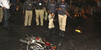 Police inspect the site of a blast that occurred during the cricket match between Pakistan and Zimbabwe, near Gaddafi Stadium in Lahore, Pakistan. Image by: STRINGER / REUTERS
