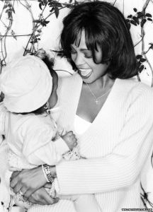 The family posted a photo of Houston with Bobbi Kristina as a baby on whitneyhouston.com with the following message: