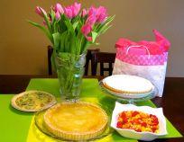 Savoury quiche, dessert pies and fruit salad.