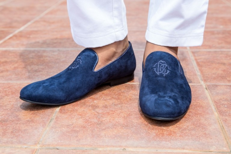This is a very interesting new piece that I've added to my shoe collection. The Papal shoe or the Papal slipper, is a twist on your regular loafer. Loosely inspired by the red Prada loafers worn by the Pope, these blue suede loafers really do look lovely on a tuxedo or a dinner jacket, but can work equally well at the workplace. I pair it with simple white trousers so that the focus remains on the shoes.