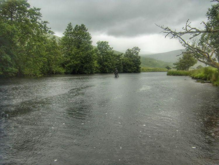 Fishing through the downpours..