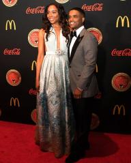 Erica Ash and Larenz Tate on carpet