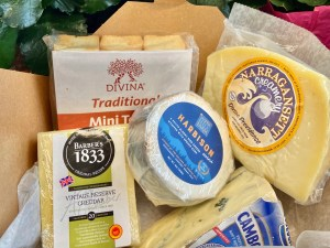 February's Cheese Share box included 4 cheeses, mini toasts, toffee cashews and a piece of chocolate.