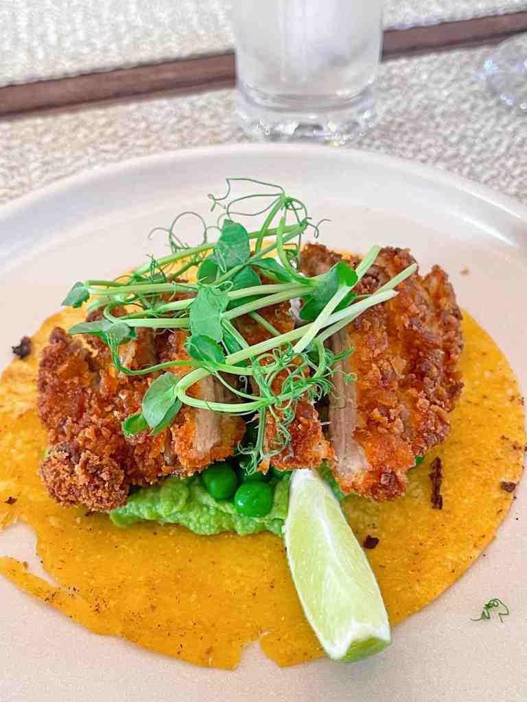 Crispy guinea fowl tacos with green pea hummus and mint sour cream at Au Jardin