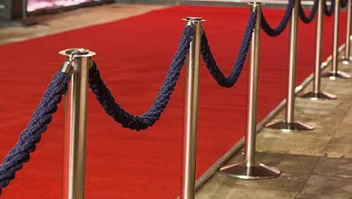 This stock photo shows the red carpet. (Credit DepositPhotos)