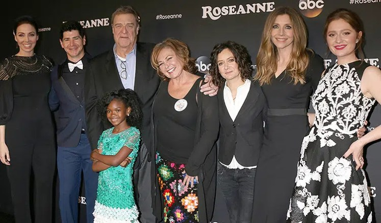 "Whitney Cummings, Michael Fishman, John Goodman, Jayden Rey, Roseanne Barr, Sara Gilbert, Sarah Chalke, Emma Kenney are shown at an event for ""Roseanne."" (Credit: Deposit Photos)"