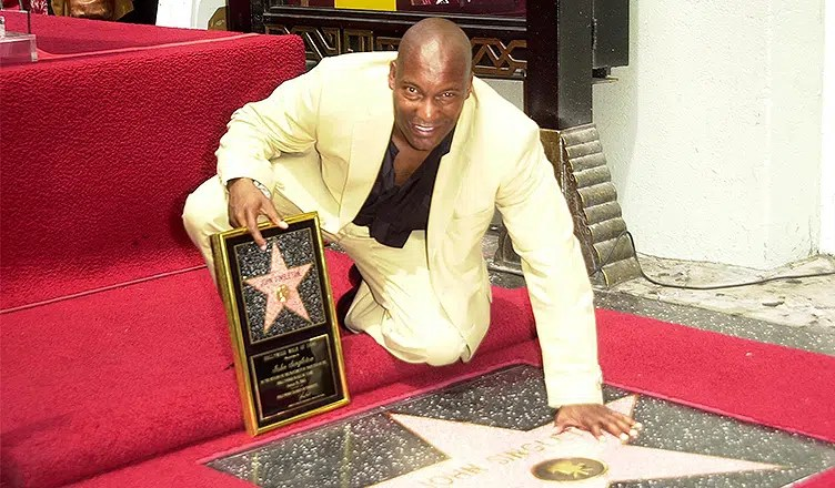 John Singleton is inducted into the Hollywood Walk of Fame, Hollywood, CA 08-26-03. (Credit: S. Bukley/Deposit Photos)