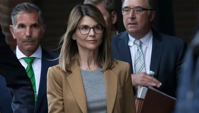Lori Loughlin and Mossimo Giannulli are shown making a court appearance. (Credit: Shutterstock)