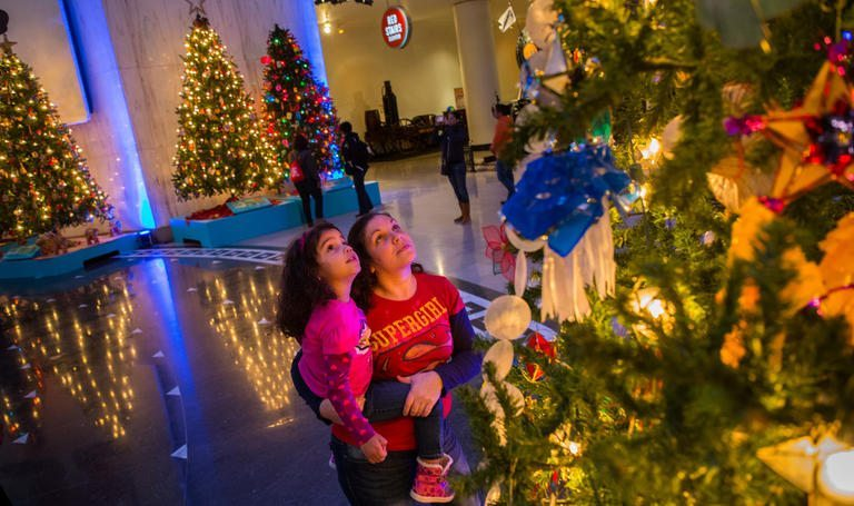 christmas around the world began in 1942 when a lone solitary tree was placed on the museum floor it was originally decorated to support the allied - Christmas Around The World Chicago