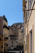 is this a mountain village or france's second largest city?
