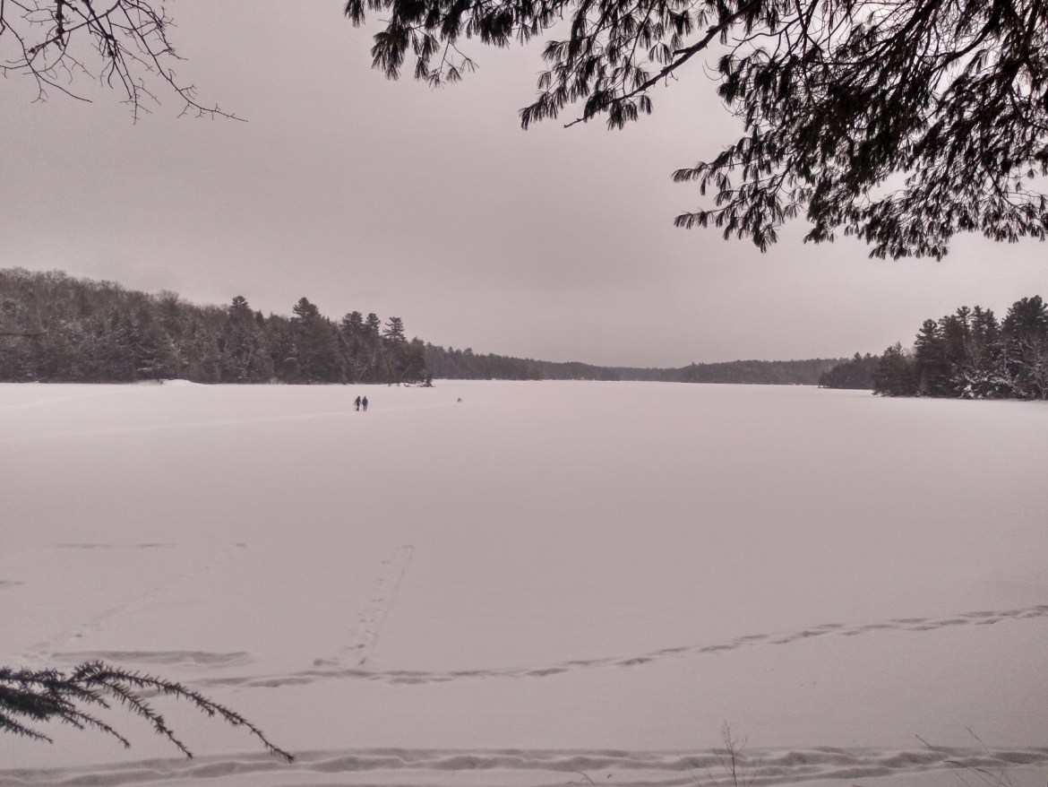Brave souls cross the frozen Silent Lake heading toward the forest and the lookout point
