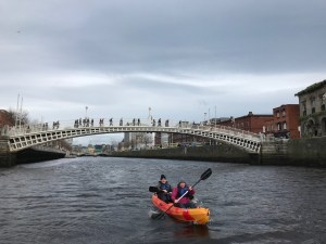 Brian and Cassandra paddle the river Liffey