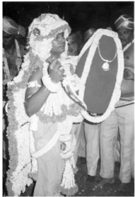 The Karaga carried by a male priest from the Tigala community of urban gardeners in Bangalore. The Karaga, dedicated to Shakti (the female principle of divinity), is Bangalore's largest civic festival, attracting over 100,000 people on the final day of a nine-day event that encompasses many areas of the city.