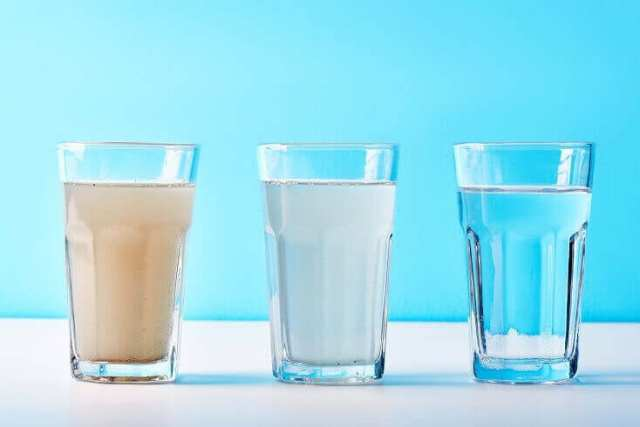 Glasses of Water Before and After Purification