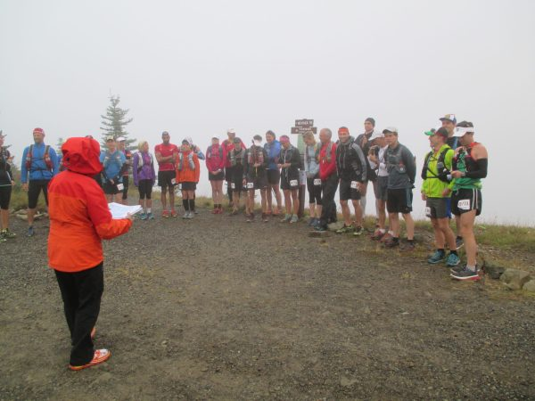 Racing in the clouds. A low key speech from the race director before taking off down single track trail.
