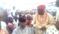 (L-R) Obarisi Ovie Omo-Agege discussing with the celebrant Chief Lori Magege